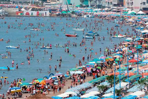 A crowded beach in the city of Durres in Albania were temperatures peaked at 42C yesterday Credit: Gent Shkullaku (AFP)