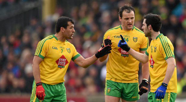 Donegal players, from left, Frank McGlynn, Michael Murphy and Mark McHugh in conversation during the game