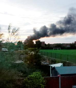 Fire at Hollygate Lane Industrial Park in Cotgrave, Nottingham where thirty firefighters are tackling the blaze Credit: @AnnaCandiceLee/PA Wire