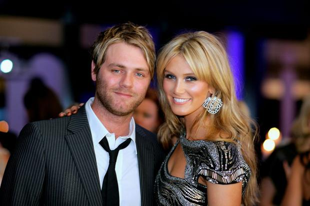 Singers Brian McFadden and Delta Goodrem attend the Madison Sex, Frocks & Rock'N'Roll dinner to celebrate and award excellence in Fashion, Music and Style at the Apple building on May 20, 2009 in Sydney, Australia. (Photo by Mike Flokis/Getty Images)
