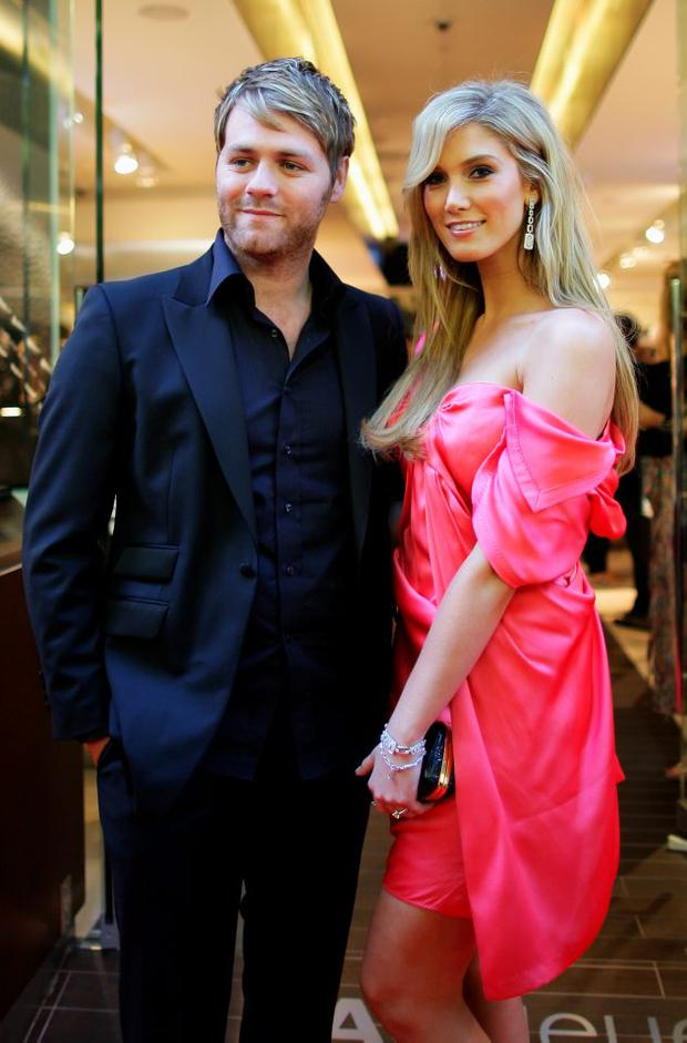 Brian McFadden (L) and Delta Goodrem arrive for the official opening of TAG Heuer's first Melbourne boutique at Collins Street on January 14, 2010 in Melbourne, Australia. (Photo by Mark Dadswell/Getty Images)