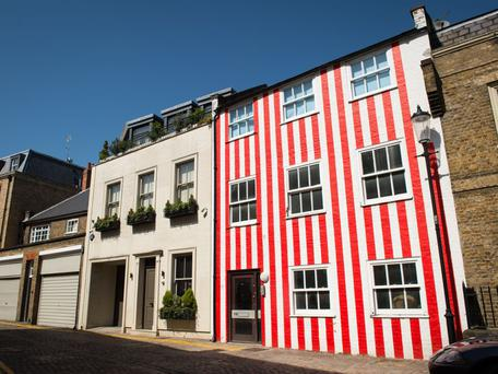 The woman painted her house in stripes to spite her neighbours