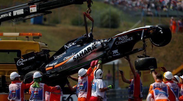 The car of Force India driver Sergio Perez of Mexico is removed by a crane after crashing, during the free practice at the Hungarian Formula One Grand Prix in Budapest, Hungary, Friday, July 24, 2015. The Hungarian Formula One Grand Prix will be held on Sunday July, 26. (AP Photo/Darko Vojinovic)