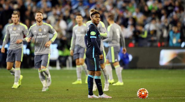 Manchester City's Raheem Sterling looks dejected after Real Madrid's second goal