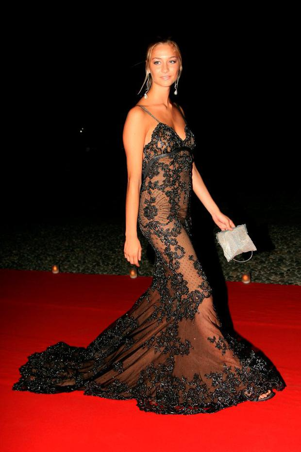 2007, Milan: Beatrice Borromeo arrives at a dinner at the Palazzo Reale in a floor-sweeping, Versace dress.
