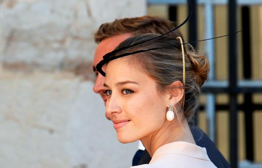 Pierre Casiraghi and girlfriend Beatrice Borromeo leave the church after the wedding ceremony of the Prince of Luxembourg with a German student on September 21, 2013 a