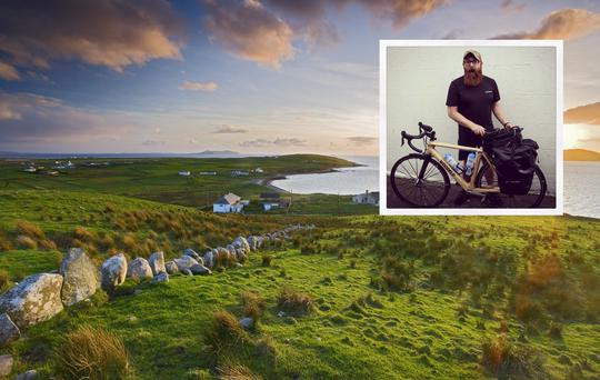 Mark Graham (inset) is cycling the Wild Atlantic Way on a wooden bike. Photo shows Clare Island.