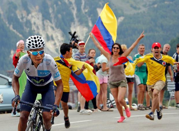 A Colombian fan cheers Movistar rider Nairo Quintana during the 138-km (85.74 miles) 19th stage of the 102nd Tour de France cycling race from Saint-Jean-de-Maurienne to La Toussuire-Les Sybelles in the French Alps mountains