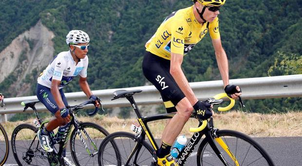 Team Sky rider Chris Froome, the race overall leader's yellow jersey, cycles with Movistar rider Nairo Quintana of Colombia during the 138-km (85.74 miles) 19th stage of the 102nd Tour de France cycling race from Saint-Jean-de-Maurienne to La Toussuire-Les Sybelles in the French Alps mountains