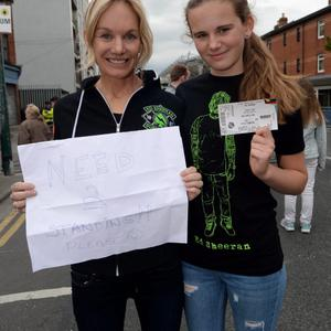 24 Jul 2015; April Powers and daughter Skyler Edgcomb, 15, from San Francisco, USA, looking for tickets to gig (one person gave them a ticket). Ed Sheeran concert, Croke Park, Dublin. Picture: Caroline Quinn