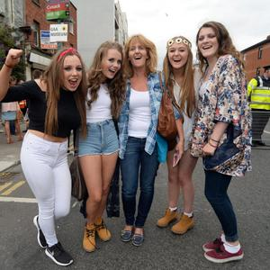 24 Jul 2015; l-r; Caoimhe Cowman, 14, Shona Geoghegan, 15 and her mother Catherine, Lauren Guider, 15, and Molly O'Dwyer, 15, from Carlow, on their way to the Ed Sheeran concert in Croke Park, Dublin. Picture: Caroline Quinn