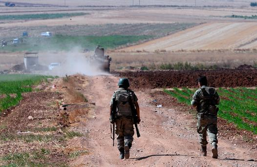 Turkish soldiers patrol near the border with Syria, ouside the village of Elbeyli, east of the town of Kilis, southeastern Turkey.