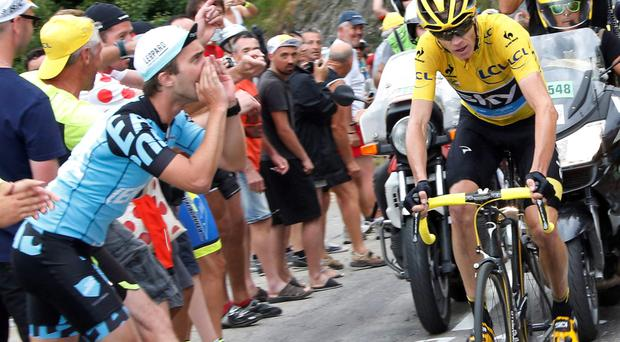 Chris Froome cycles past spectators as he climbs to La Toussuire during the 138km 19th stage