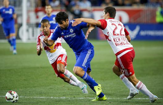 "Chelsea's Diego Costa, centre, in action with New York Red Bulls' Karl Ouimette (R) and Tyler Adams (L) as he vows to be ready to ""fight hard"" again this season"