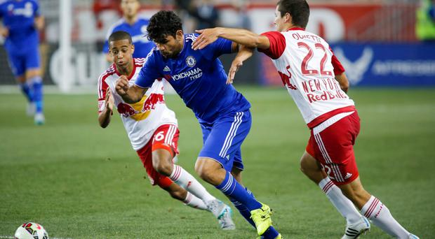 """Chelsea's Diego Costa, centre, in action with New York Red Bulls' Karl Ouimette (R) and Tyler Adams (L) as he vows to be ready to """"fight hard"""" again this season"""