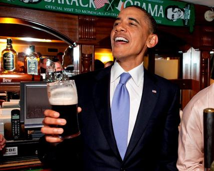 Barack Obama samples a Guinness in Ireland in 2011