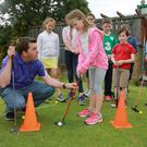 David Lavelle, a PGA Pro who runs the golf camp at Spawell Golf Centre, teaches Riona Monadhan (9) from Rathmines