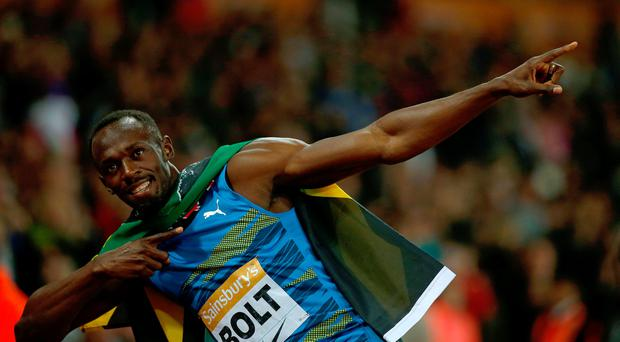 Jamaica's Usain Bolt creates his 'Lightening Bolt' poses as he celebrates winning the men's 100m Final