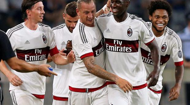 AC Milan's Philippe Mexes (C) celebrates with teammate Cristian Eduardo Zapata Valencia (2nd R) after Mexes scored a goal against Inter Milan during their International Champions Cup friendly soccer match in Shenzhen, China. REUTERS/Bobby Yip