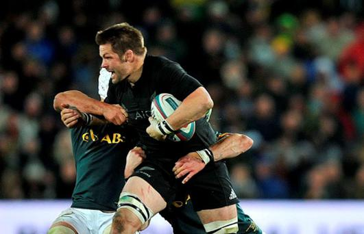 New Zealand's flanker and Captain Richie McCaw is tackled during the test match between South Africa and New Zealand