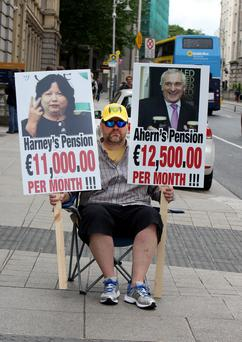 MAKING HIS POINT: A voice of protest outside the Banking Inquiry. Photo: Tom Burke