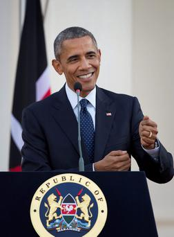 U.S. President Barack Obama makes a joke while answering a question from the media about the dinner he had with his Kenyan relatives