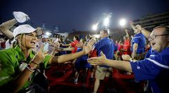 U.S athletes, right, are greeted by volunteers and athletes from the Great Britain as they enter the stadium during the opening ceremony of the 2015 Special Olympics World Games, Saturday, July 25, 2015, in Los Angeles. (AP Photo/Jae C. Hong)