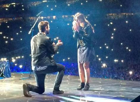 Jay Boland of Kodaline proposes to girlfriend Eatoin Corr on stage with Ed Sheeran PIC: Kodaline Twitter
