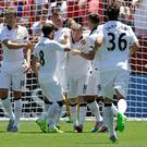 Manchester United's Wayne Rooney, center, celebrates with teammates after scoring a goal against FC Barcelona during the first half of an International Champions Cup soccer match in Santa Clara