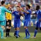 Chelsea's Thibaut Courtois (L) celebrates with his teammates after scoring a goal from a penalty Action Images via Reuters / Chris Keane Livepic