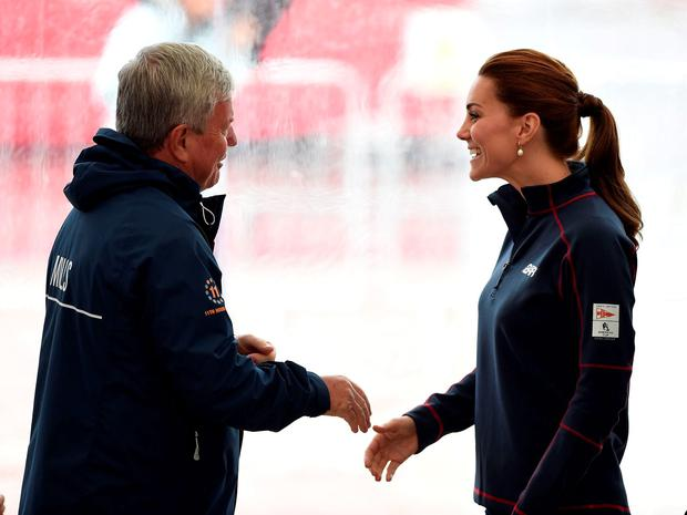 The Duchess of Cambridge is greeted by Sir Keith Mills as she arrives at the team technical areas at the Royal Navy Historic Dockyard, Portsmouth, during a visit on the second day of the opening leg of the America's Cup World Series being staged in waters off Portsmouth. drew Matthews/PA Wire