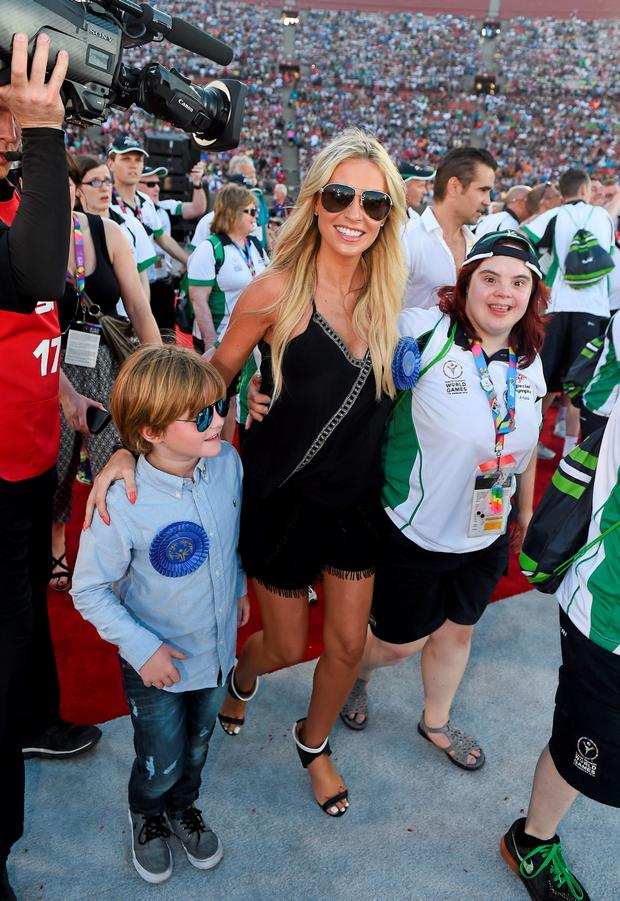 Team Ireland's Aoife O'Sullivan, a member of Owenabue Special Olympics Gymnastics Club, from Cork City, with Claudine Keane and her son Robert during the opening ceremony of the Special Olympics World Summer Games. LA Memorial Coliseum, Los Angeles, United States. Picture credit: Ray McManus / SPORTSFILE