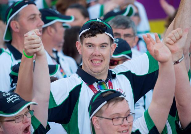 24 July 2015; Team Ireland's Keith Butler, a member of D6 Special Olympics Club. From Walkinstown, Dublin, waves to supporters as he arrives on the field during the opening ceremony of the Special Olympics World Summer Games. LA Memorial Coliseum, Los Angeles, United States. Picture credit: Ray McManus / SPORTSFILE
