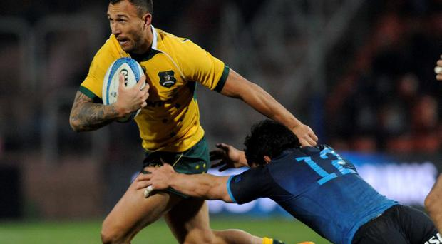 Australia's Wallabies' Quade Cooper (L) is tackled by Argentina's Los Pumas' Juan Pablo Socino (R) during the Rugby Championship 2015 test match at Malvinas Argentinas stadium in Mendoza last night