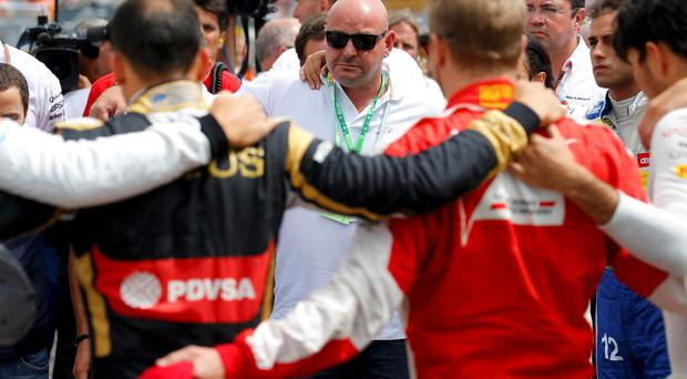 Philippe Bianchi (C), the father of Jules Bianchi, and Formula 1 drivers observe a minute's silence in memoriam of late French Formula One driver Jules Bianchi