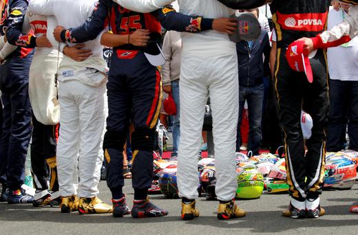 Formula 1 drivers observe a minute of silence in memoriam of late French Formula One driver Jules Bianchi before the Hungarian F1 Grand Prix at the Hungaroring circuit, near Budapest, Hungary July 26, 2015. REUTERS/Laszlo Balogh