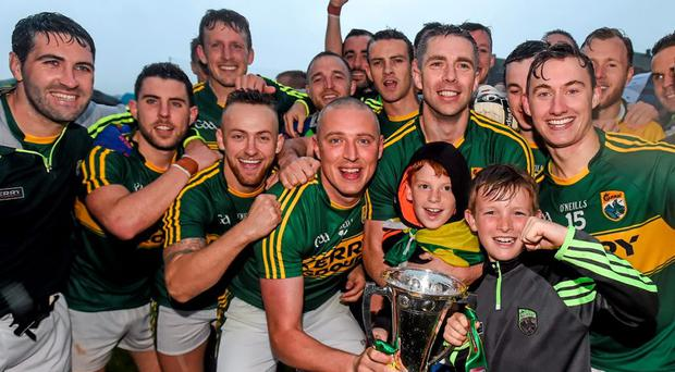Kerry captain Kieran Donaghy and team-mates celebrate with supporters and the cup after winning the Munster title last week