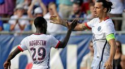Paris Saint-Germain's Zlatan Ibrahimovic, right, celebrates his goal against Chelsea during the first half of an International Champions Cup soccer match in Charlotte