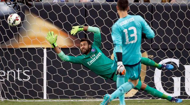 Chelsea's Thibaut Courtois, front, kicks the winning goal past Paris Saint-Germain's Salvatore Sirigu, back, after the second half of an International Champions Cup soccer match in Charlotte