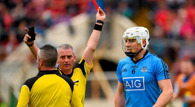 26 July 2015; Liam Rushe, Dublin, receives a red card from referee Johnny Ryan. GAA Hurling All-Ireland Senior Championship, Quarter-Final, Dublin v Waterford. Semple Stadium, Thurles, Co. Tipperary. Picture credit: Stephen McCarthy / SPORTSFILE