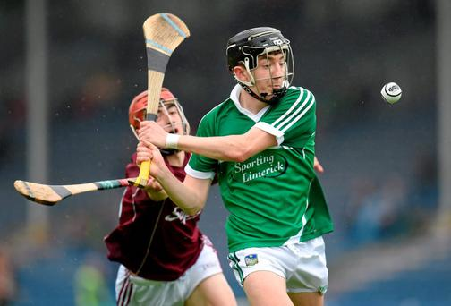 Limerick's Michael Mackey is closed down by Galway's Jack Grealish during their Electric Ireland MHC quarter-final