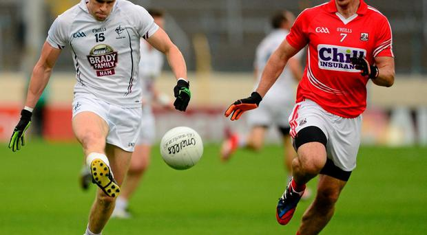 Kildare's Cathal McNally up against Cork's Barry O'Driscoll