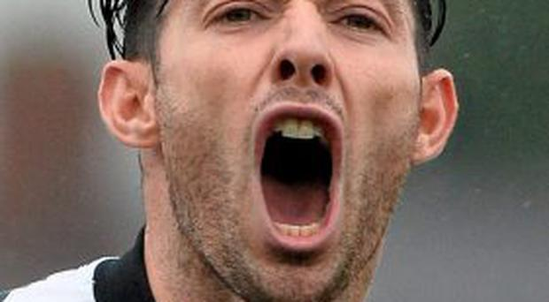 Richie Towell celebrates after scoring