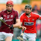 Galway's man-of-the-match Johnny Glynn surges away from Mark Ellis during yesterday's victory against Cork STEPHEN MCCARTHY/SPORTSFILE