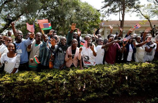 Crowds line the motorcade route as U.S. President Barack Obama travels to deliver remarks at an indoor stadium in Nairobi