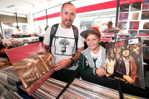 Brett Taylor, from Melbourne, with his son, Campbell, 13, holding records at the Music, CD & Record Fair at Filmbase in Temple Bar. Damien Eagers / Irish Independent 24/7/2015