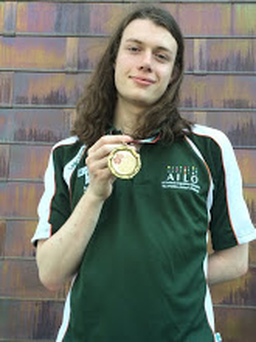 Luke pictured with his bronze medal in Bulgaria