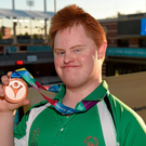 Team Irelands Gary McEnroe, a member of St John of God Menni Services, from Tallaght, Dublin, with his Bronze Medal - 25M Backstroke, at the Uytengsu Aquatics Center. Special Olympics World Summer Games, Los Angeles, California, United States. Picture credit: Ray McManus / SPORTSFILE