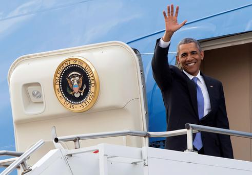 US President Barack Obama waves as he boards Air Force One prior to his departure from Kenyatta International Airport in Nairobi on July 26, 2015. AFP/Getty Images