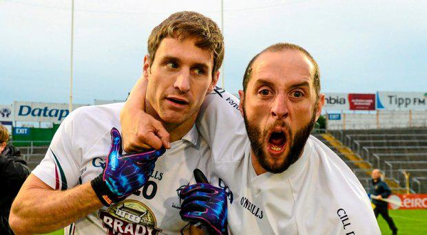 A Kildare supporter embraces Gary Whyte after the game